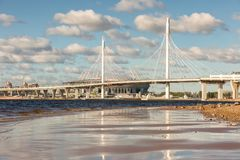 New highway road with cable-stayed bridge over the Neva river in. St.Petersburg, Russia Stock Images