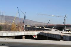 New highway under construction. A new bridge freeway made of concrete and metal to pass traffic from big city. An unfinished interstate bridge. Road under Royalty Free Stock Photo