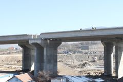 New highway under construction. A new bridge freeway made of concrete and metal to pass traffic from big city. An unfinished interstate bridge. Road under Stock Photo