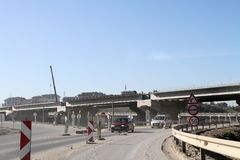 New highway under construction. A new bridge freeway made of concrete and metal to pass traffic from big city. An unfinished interstate bridge. Road under Stock Image