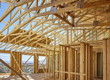 New hillside home wall framing and scissors roof truss details Stock Photos