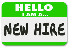 New Hire Nametag Sticker Green Employee Rookie Fresh Talent. Hello I Am a New Hire words written on a green nametag sticker for a rookie employee or fresh talent Royalty Free Stock Photos