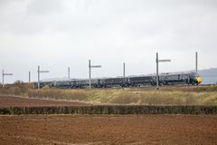 Hitachi Train passing partially completed electrification Royalty Free Stock Photos