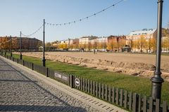 In New Holland there will be an ice rink. ST. PETERSBURG, RUSSIA - OCTOBER 16, 2018: New Holland, worker prepares a site for ice rink royalty free stock photos