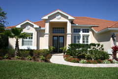 New Home. New upscale home with square columns and unique tile roof royalty free stock photos