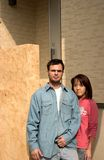 New home. Interracial couple standing on a doorstep Stock Image