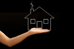 A new home. Symbol over black background Royalty Free Stock Photo