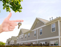 New home. Community dwelling , condo.  hand with keys Stock Photo