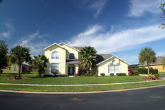 New Home 2. A new home with blue sky and palm trees Royalty Free Stock Photos