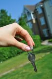 New home. Female hand holding a key to a house Stock Photo