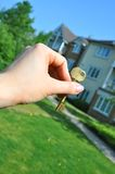 New home. Female hand holding a key to a house Stock Images