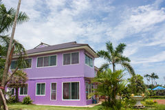New home. Another point of view. Tidy and beautiful new home in the tropics purple roof Royalty Free Stock Images