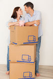 New home. Happy parents dreaming new home with piggy bank for money Royalty Free Stock Image