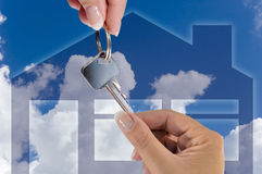 New home. Conceptual photograph of someone receiving the key for their new home Royalty Free Stock Photos