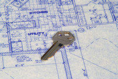 New Home. House key laying on top of blueprints Royalty Free Stock Image