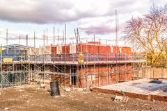 New Home Building. Construction site building a new brick home stock photos