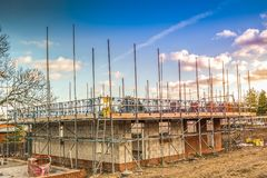 New Home Building. Construction site building a new brick home royalty free stock photo