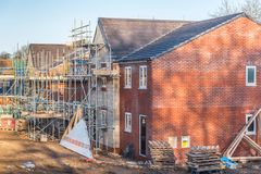 New Home Building. Construction site building a new brick home royalty free stock photos