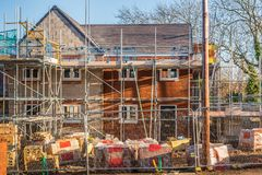 New Home Building. Construction site building a new brick home stock image