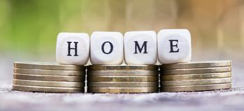 New home buy - money coins with letters Stock Photo