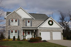 New Home - Christmas Time. New two story brick home at Christmas time Royalty Free Stock Image