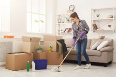 Young woman cleaning home with mop royalty free stock photo