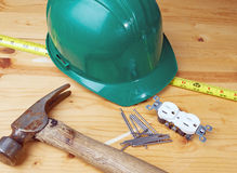 New Home Construction. Construction items including a hard hat and framing hammer on pine boards Stock Photography