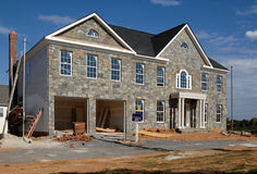 New home construction. A new home under construction against a blue sky stock images