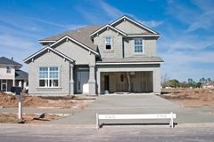 New home construction. Partially complete new home with prepped concrete exterior and fresh concrete driveway Royalty Free Stock Photography
