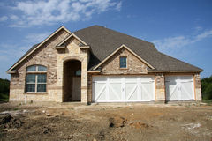 New home construction. New suburban brick house  construction, TX America Stock Image