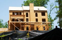 New Home Construction. Back of a new home under construction showing the rows of silt barriers royalty free stock photos