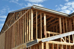 New Home Construction with Blue Sky and Clouds Stock Photos