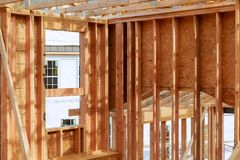 New home construction. build with wooden truss, post and beam framework. New construction home framing New build with wooden truss, post and beam framework Stock Photos