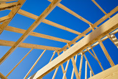 New home construction framing. New construction home framing against blue sky, closeup of ceiling frame royalty free stock image