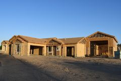 New Home Construction Framing In The Southwest. New home construction framing for a house that is being built in Gilbert Arizona in the Southwest part of the stock photo