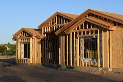 New Home Construction Framing In The Southwest. New home construction framing for a house that is being built in Gilbert Arizona in the Southwest part of the royalty free stock images