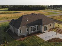 Free New Home Construction From Above. Aerial View Of Suburban House. American Neighborhood, Suburb. Summer, Sunny Day Stock Photos - 168247323
