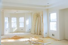 New home construction interior room with unfinished wood floors and twin closets. The electrical and hvac connections also are partially unfinished royalty free stock photos