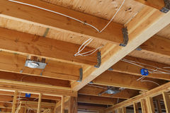New home construction lights and ceiling, detail. New home construction lights and ceiling Royalty Free Stock Images