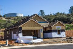 New Home Construction With Roofing Materials On Top Of Building Royalty Free Stock Photo