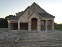 New home construction at sunset Stock Images