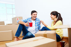 New home couple. Couple celelbrating new home handing keys and moving boxes Stock Photo