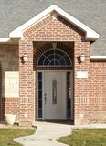 New Home Entry Way. New Upscale brick home in nice neighborhood with pretty entrance way Royalty Free Stock Images