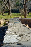 New home foundation. A view of the newly poured concrete foundation of a home under construction in the country stock photography