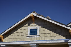 New home gable shingles roofing and stucco Royalty Free Stock Images