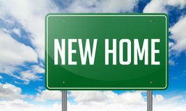 New Home on Green Highway Signpost. Royalty Free Stock Photo