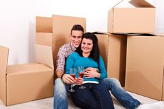 New home: happy moving coupe Royalty Free Stock Photo