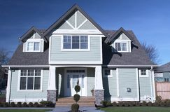 New Home House Canada Exterior. Front entrance view of a new custom built home royalty free stock image