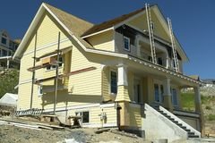New Home House Construction. New yellow country design home under construction Stock Photos