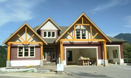 New Home House Construction. New custom designed home under construction royalty free stock photo